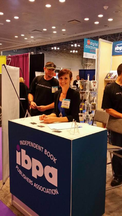 Me at the IBPA booth, and that's one of my team members behind me.